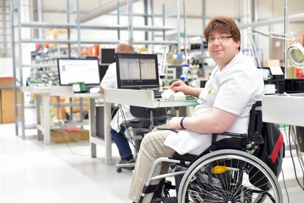 Man in wheelchair in factory
