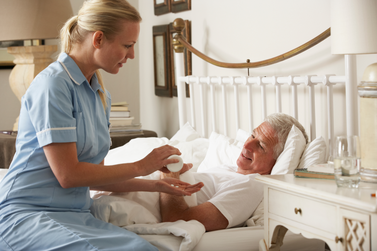 hospice nurse taking care of patient at home