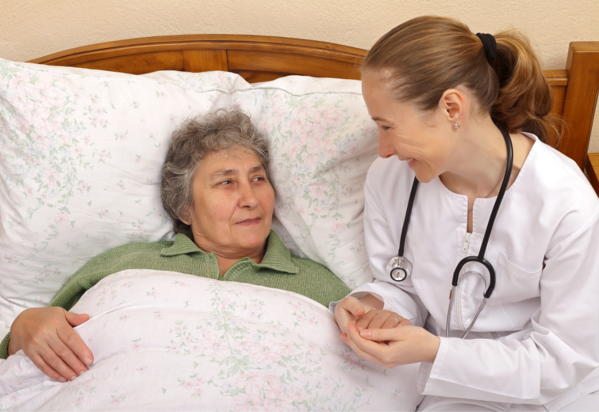 doctor at elderly woman's bedside
