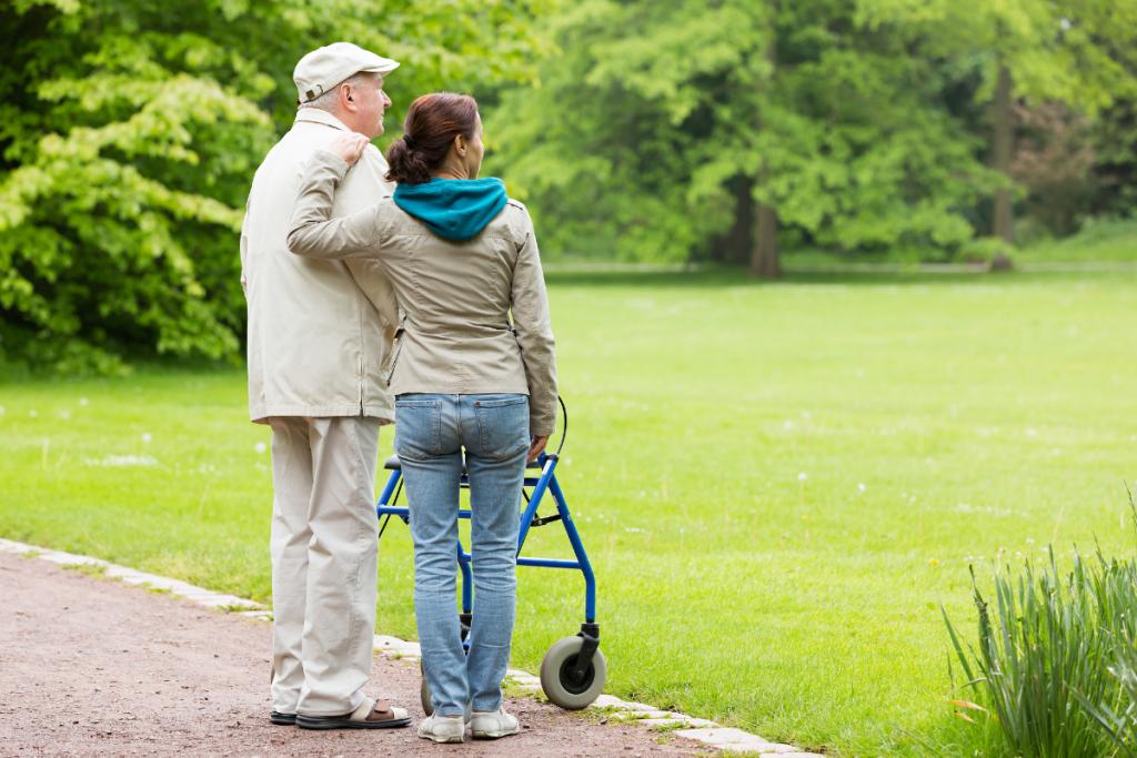 elderly man with caretaker